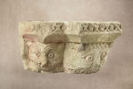 A sculpted limestone column corner capital