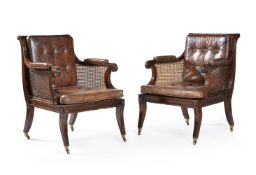 A pair of mahogany library bergere armchairs