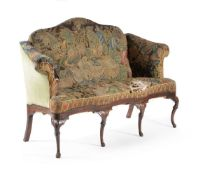 A George II walnut and tapestry upholstered sofa