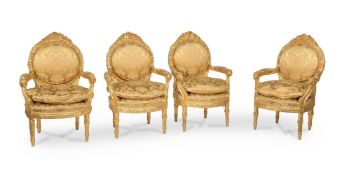 A set of four carved giltwood armchairs