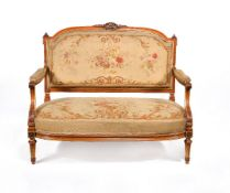 A Victorian solid satinwood, parcel gilt and tapestry upholstered settee, circa 1870