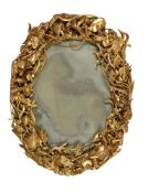 A carved giltwood oval wall mirror