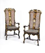 A pair of black lacquer and gilt chinoiserie decorated armchairs
