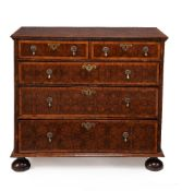 A William & Mary olivewood oyster veneered and walnut banded chest of drawers