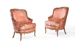 A pair of Louis XV carved beech armchairs