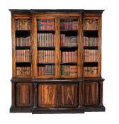 ϒ A Colonial solid coromandel breakfront library bookcase