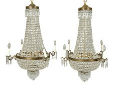 A pair of cut glass and gilt metal mounted four branch chandeliers in Regency taste