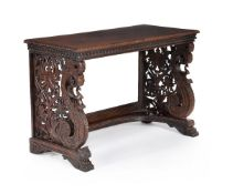 A pair of Anglo Indian carved hardwood console tables