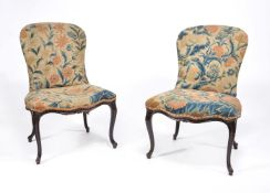 A pair of George III mahogany and needlework upholstered side chairs