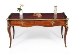 A Louis XV walnut and gilt metal mounted bureau plat
