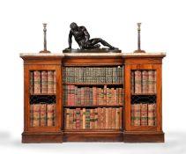 ϒ A Regency rosewood and marble mounted inverted breakfront bookcase