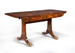 ϒ A Regency rosewood, coromandel banded and gilt metal mounted sofa table