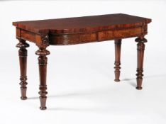 A pair of George IV figured mahogany side tables