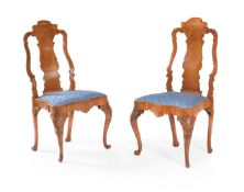 A pair of figured walnut and marquetry side chairs