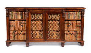 ϒ A Regency rosewood and gilt metal mounted breakfront bookcase