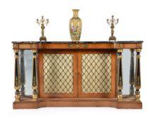 ϒ A Regency rosewood and gilt metal mounted inverted breakfront side cabinet