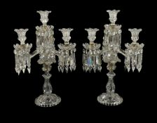 A pair of Baccarat four light cut and moulded glass candelabra