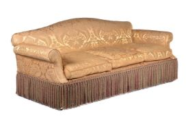 A pair of damask upholstered three seat sofas