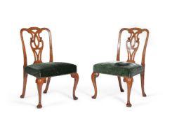 A set of six George II walnut dining chairs