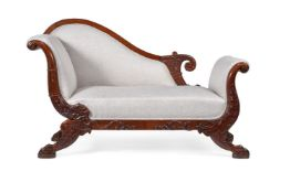A Continental carved mahogany and upholstered day bed