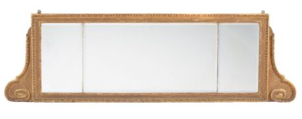 A George II carved giltwood triptych wall mirror