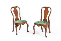 A pair of George II walnut chairs