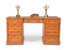 A Victorian satinwood pedestal desk