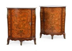 A pair of tulipwood and specimen marquetry corner cabinets