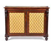 ϒ A George IV rosewood and gilt metal mounted side cabinet