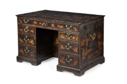 A Chinese Export black and gilt lacquer kneehole desk