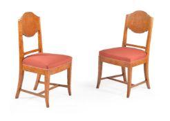 A set of eighteen Baltic karelian birch dining chairs