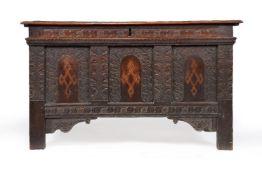 An Elizabethan panelled oak chest or coffer, circa 1580