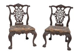 A pair of carved mahogany chairs