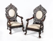 ϒ A pair of Ceylonese padouk or hardwood armchairs