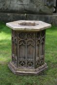 A stone and brass mounted font in gothic style