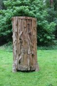 A carved driftwood twin door cabinet
