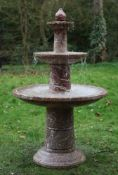 A three tier fountain carved from variegated rose marble