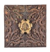 A Continental probably Italian, carved, gilded and painted walnut ceiling armorial panel