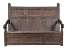 A carved oak settle