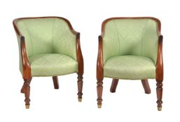 A pair of George IV mahogany and upholstered armchairs