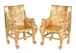 A pair of carved giltwood armchairs