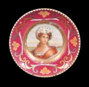 A Russian porcelain (Kuznetzov Factory) portrait plate painted with a woman wearing elaborate headre