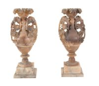 A pair of Italian turned and carved alabaster vases