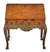 A walnut and seaweed marquetry bureau on stand