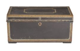 A leather and brass bound camphorwood trunk