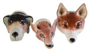 A Staffordshire bone china fox mask stirrup cup