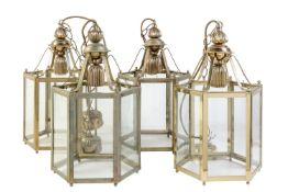 A set of four gilt metal and glazed hexagonal hall lanterns