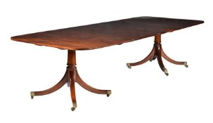 A mahogany twin pillar dining table in late George III style