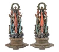 A pair of Victorian painted cast iron door porters modelled as trophies of war