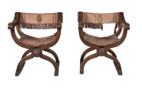 A pair of walnut and silk upholstered X-framed chairs, in 17th century style